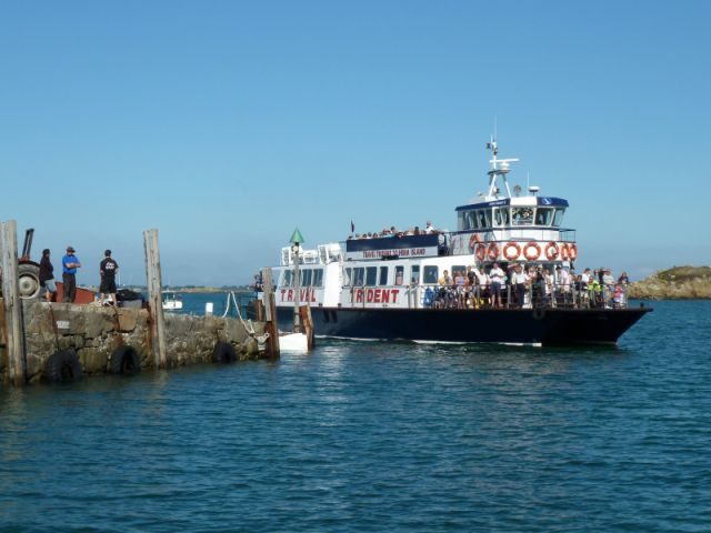 The Travel Trident coming in to Herm Harbour at fairly high tide. The steps are marked with white paint