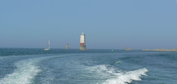 Approaching River Jaudy with La Corne lighthouse behind.  Note green buoy which you must go around